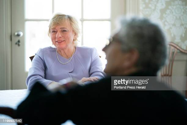 Gov Janet Mills talks with Maine Poet Laureate Stuart Kestenbaum while recording the reading of a poem titled Why do you ask by Kate Barnes at the...