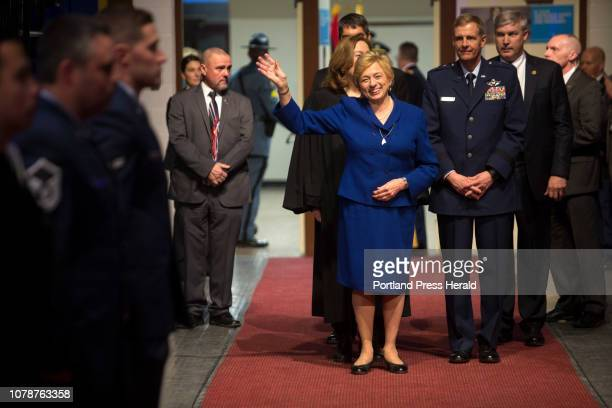 Gov Janet Mills waves to the crowd as she enters the Augusta Civic Center before being sworn in as the 75th governor of Maine during her inauguration...
