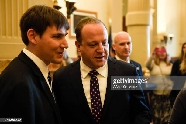 Gov Jared Polis and his partner Marlon Reis look at student art on display after his inauguration at the Colorado State Capitol on Tuesday January 8...