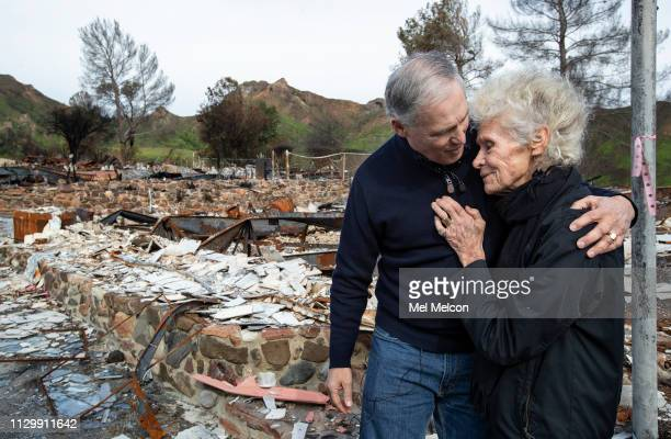 Gov Jay Inslee of Washington comforts Marsha Maus a 15 year resident of Seminole Springs Mobile Home Park whose home was destroyed during...