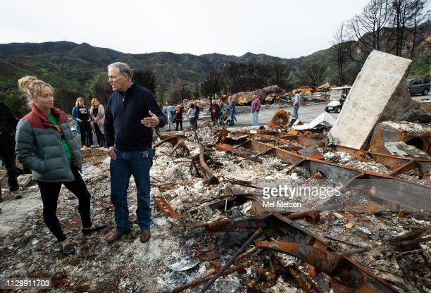 Gov Jay Inslee of Washington talks with Annie O'Connor a 6 year resident of Seminole Springs Mobile Home Park whose home was destroyed during...