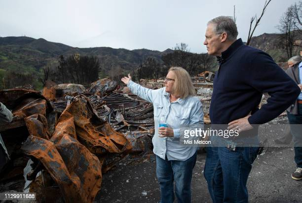 Gov. Jay Inslee of Washington talks with Becky Christensen a 10 year resident of Seminole Springs Mobile Home Park whose home was destroyed during...