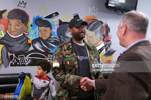 Gov John Bel Edwards greets Blake J Stanfill at the Case Closed Barbershop on November 15 2019 in New Orleans Louisiana Louisiana residents head to...