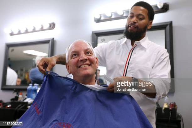 Gov John Bel Edwards receives a touch up by Daryl Womack owner of Case Closed Barbershop on November 15 2019 in New Orleans Louisiana Louisiana...