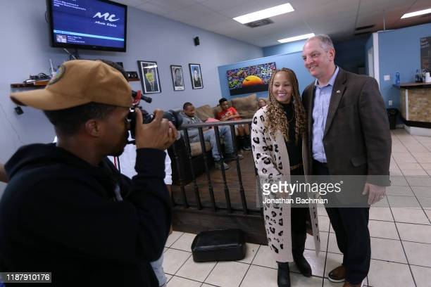 Gov John Bel Edwards takes a picture with a voter at the Case Closed Barbershop on November 15 2019 in New Orleans Louisiana Louisiana residents head...