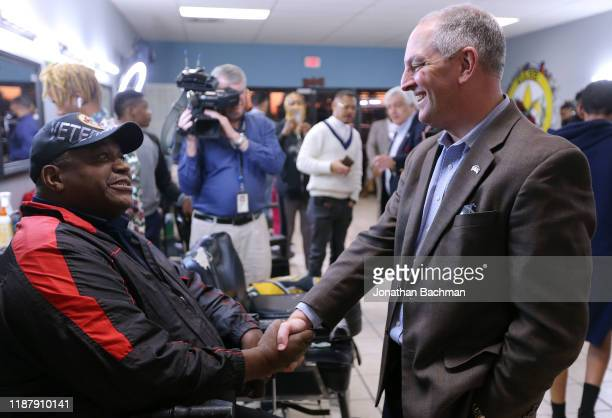 Gov John Bel Edwards talks to Solomon Murray at Case Closed Barbershop on November 15 2019 in New Orleans Louisiana Louisiana residents head to the...