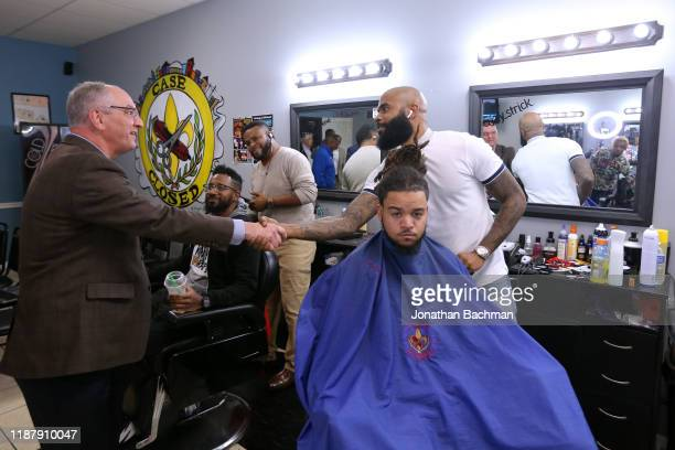 Gov John Bel Edwards talks to voters at Case Closed Barbershop on November 15 2019 in New Orleans Louisiana Louisiana residents head to the polls...