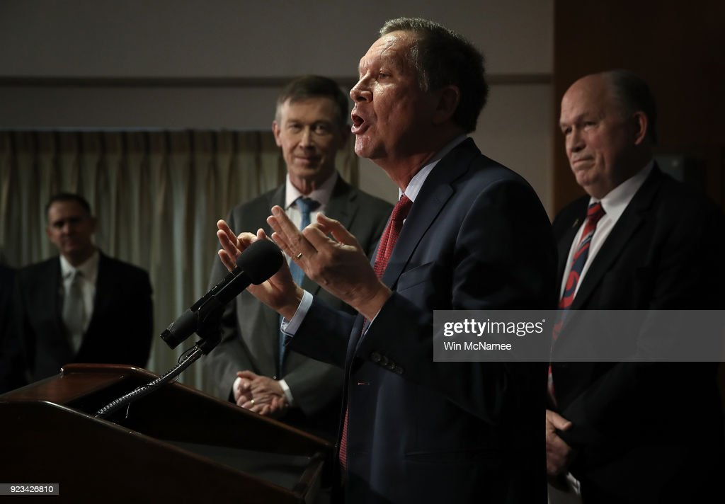 Gov. John Kasich (C) (R-OH), Gov. John Hickenlooper (L) (D-CO), and Gov. Bill Walker (R) (I-AK) speak during a press conference February 23, 2018 in Washington, DC. The three governors unveiled a blueprint for improved health care in the U.S. during the press conference.