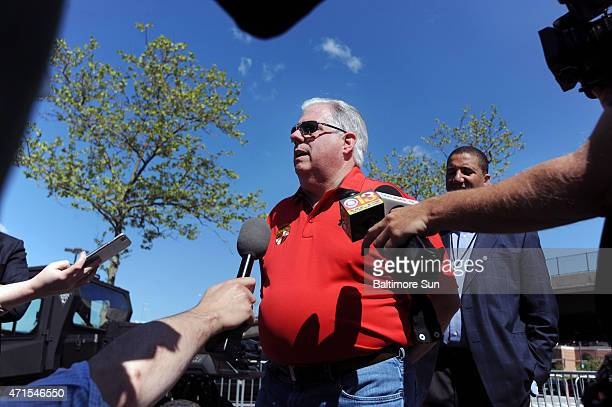 Gov. Larry Hogan speaks with the media in the parking lot between Orioles Park and Ravens stadium on April 29, 2015 in Baltimore, Md. Keiffer...
