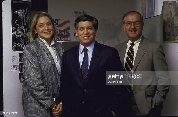Gov Michael S Dukakis' presidential campaign team manager Susan Estrich cochairman Paul Brountas and John Sasso