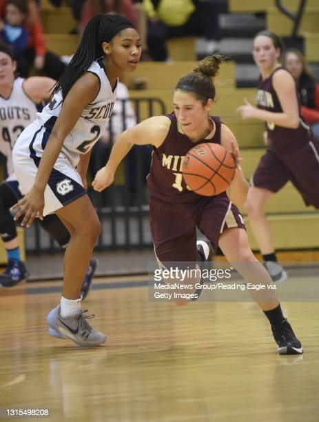 Gov. Mifflin's Melissa Martin dribbles the ball up the court with Conrad Weiser's TaCari Talford not far behind during a basketball game at Conrad...