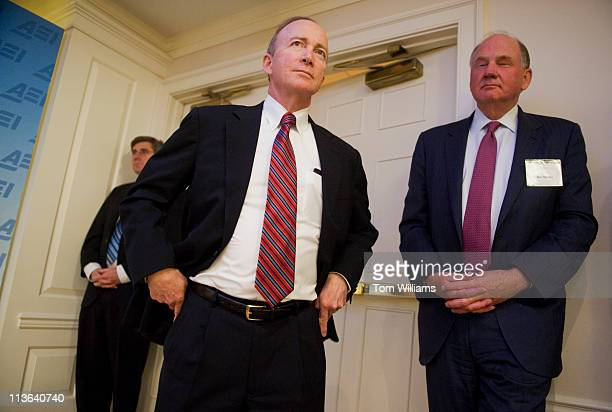 Gov. Mitch Daniels, R-Ind., center, arrives at the American Enterprise Institute in downtown Washington, to deliver a speech on education policies in...
