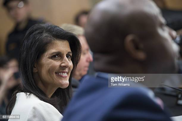 Gov Nikki Haley RSC Presidentelect Trump's nominee to be US ambassador to the United Nations is introduced by Sens Lindsey Graham RSC center and Tim...