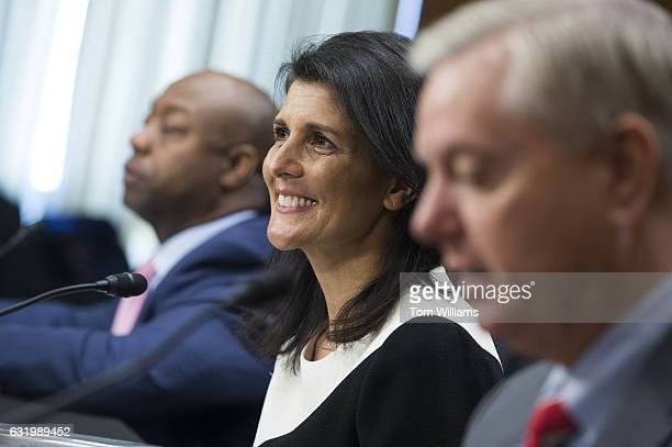 Gov Nikki Haley RSC Presidentelect Trump's nominee to be US ambassador to the United Nations is introduced by Sens Lindsey Graham RSC right and Tim...