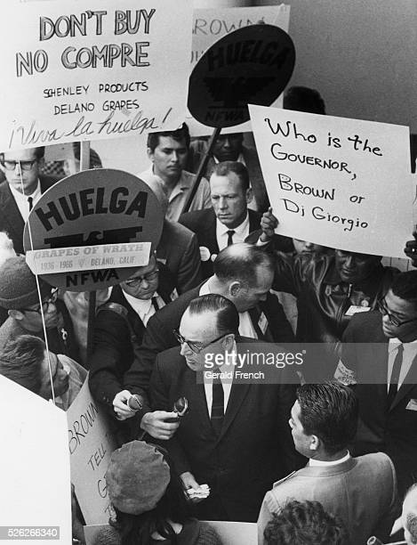 CA Gov Pat Brown being confronted by UFW's union leaders as he was sneaking out of a Bakersfield CA meeting 1966