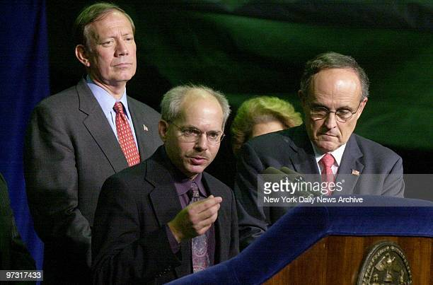 Gov Pataki Dr Stephen Ostroff associate director for epidemiologic science at the Centers for Disease Control and Prevention and Mayor Giuliani hold...