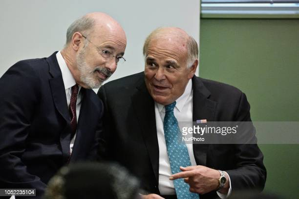 PA Gov Tom Wolf and former Gov Ed Rendell chat ahead of a forum at the School District headquarters in Philadelphia PA on October 10 2018
