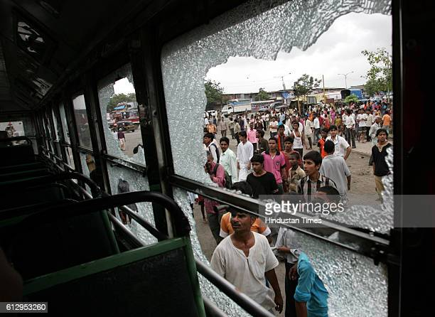Govandi Riots Communal Violence Mob Violence onlookers peep in the BEST bus that was damaged by the rioters in Govandi