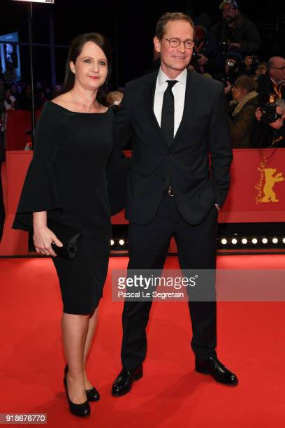 Governing Mayor of Berlin Michael Mueller and his wife Claudia attend the Opening Ceremony 'Isle of Dogs' premiere during the 68th Berlinale...