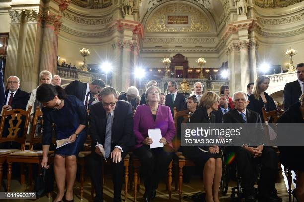 TOPSHOT Governing Mayor of Berlin Michael Mueller and his wife Claudia Mueller German Chancellor Angela Merkel Ingeborg Schaeuble and the President...