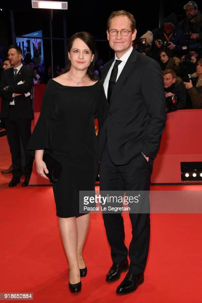 Governing Mayor of Berlin Michael Mueller and his wife Claudia attends the Opening Ceremony 'Isle of Dogs' premiere during the 68th Berlinale...