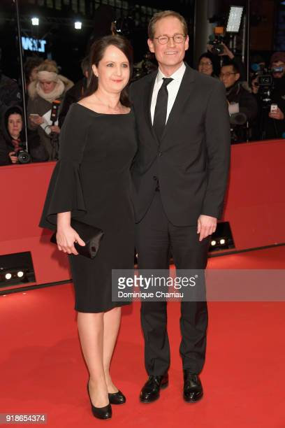Governing Mayor of Berlin Michael Mueller and his wife Claudia Mueller attend the Opening Ceremony 'Isle of Dogs' premiere during the 68th Berlinale...