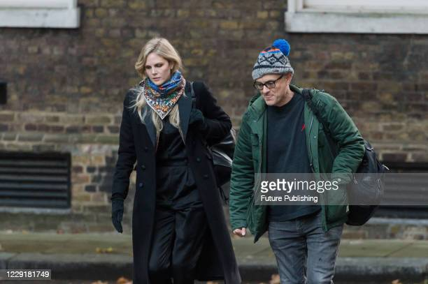 Government Adviser Cleo Watson and Special Political Adviser for the Prime Minister of the UK Dominic Cummings arrive in Downing Street in central...