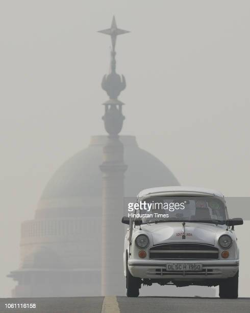 A government Ambassador car passes through a thick layer of smog at Rashtrapati Bhawan on November 13 2018 in New Delhi India Pollution levels in...
