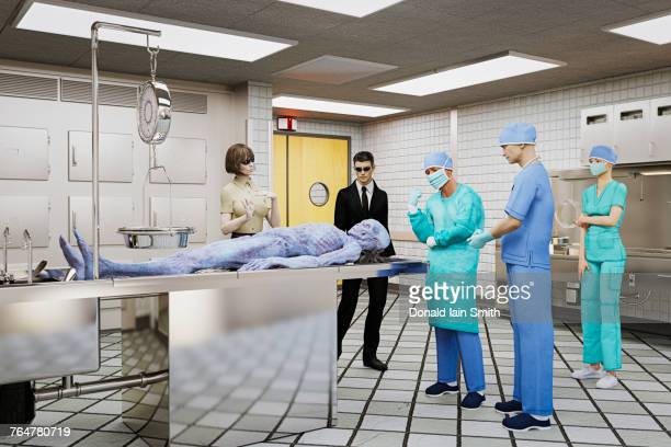 government and doctors examining dead alien - autopsy stock-fotos und bilder