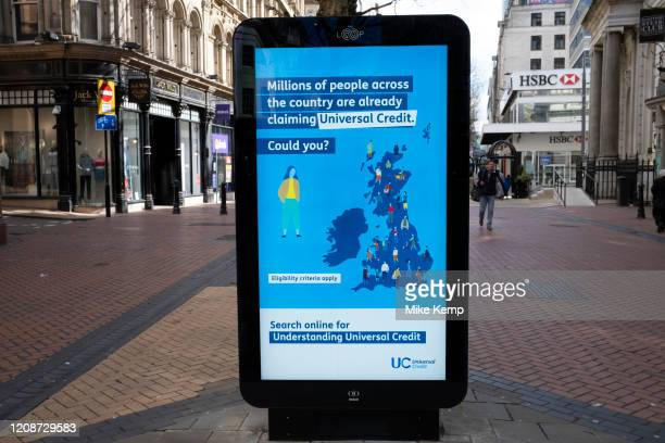 HM Government and NHS advertising boards advice for claiming Universal Credit in Birmingham city centre is virtually deserted due to the Coronavirus...