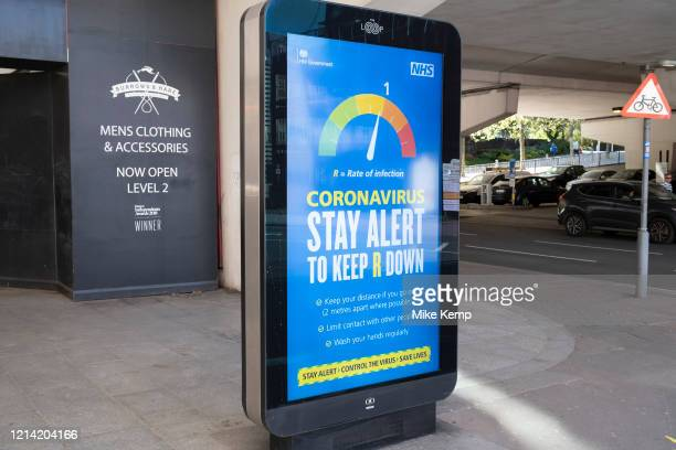Government, and NHS advertising boards advice to stay alert to keep the R down and help save lives in Birmingham city centre which has very few...