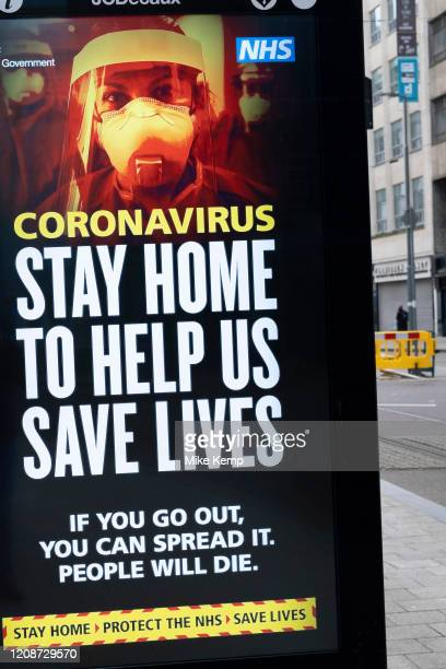 HM Government and NHS advertising boards advice to stay at home and help save lives in Birmingham city centre is virtually deserted due to the...