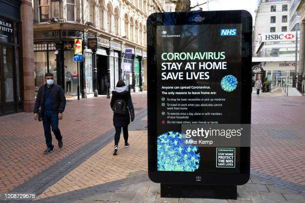 Government, and NHS advertising boards advice to stay at home and help save lives in Birmingham city centre is virtually deserted due to the...
