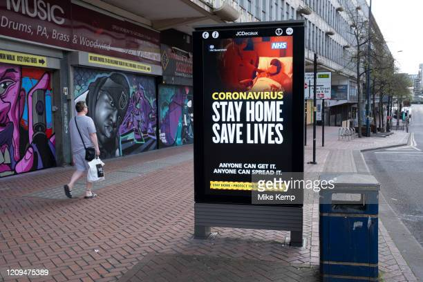 Government, and NHS advertising boards advice to stay at home and help save lives on Smallbrook Queensway in the city centre as people observe the...