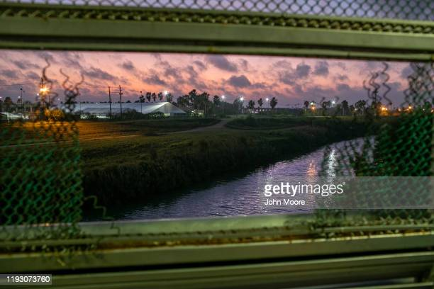 Government border facilities, including an immigration court, can be seen in Brownsville, Texas from the international bridge over the Rio Grande on...