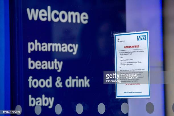Government coronavirus information leaflet sits in the window of a Boots store, operated by Walgreens Alliance Boots, in London, U.K., on Monday,...
