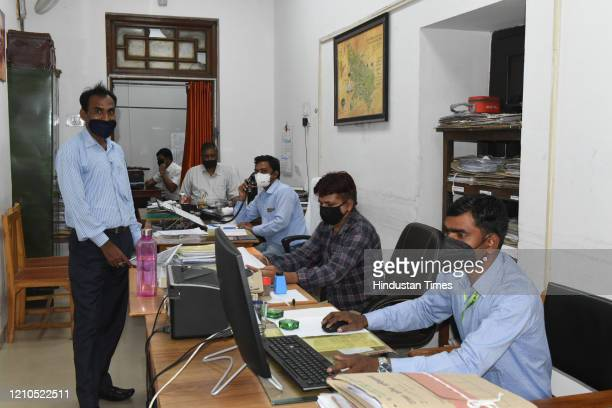 Government employees resume working from office at the Vidhan Sabha Secretariat, on April 20, 2020 in Lucknow, India.