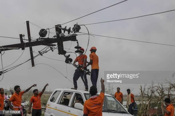 Government employees work on damaged transmission masts after Cyclone Fani passes in the Puri district of Odisha India on Saturday May 4 2019 A...