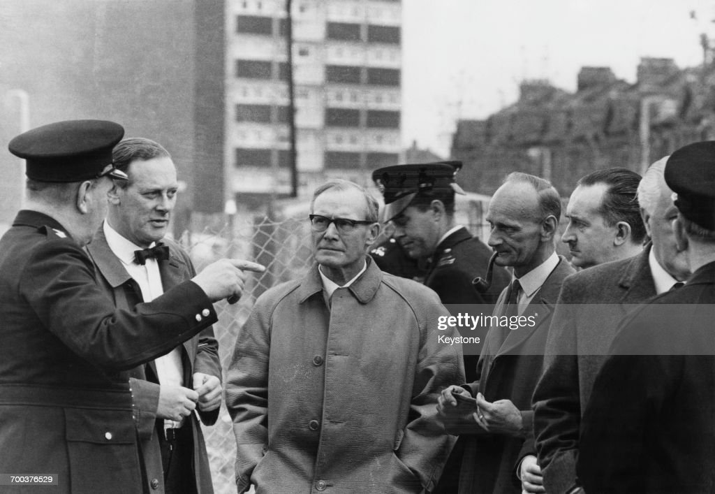 Government experts visiting Ronan Point two days after the 22-storey tower block partly collapsed after a gas explosion, killing four and injuring 17, Newham, London, 18th May 1968. At the head of the team is chief architect to the Ministry of Housing H.J. Whitfield Lewis (1911 - 2010, second from left).