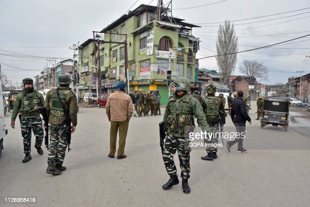 Government forces are seen standing alert in Srinagar Tension gripped in Kashmir valley after scores of profreedom leaders and activists were...