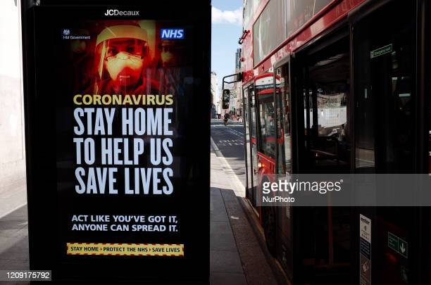 Government guidance to stay at home is displayed on a digital advertising screen at a bus stop on New Oxford Street in London England on April 4 2020...