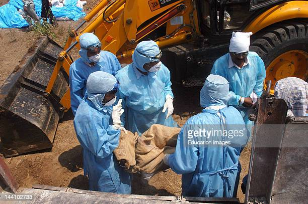 Government Health Workers Carry Infected Poultry In A Jute Sack For Culling From The Backyard Of The Villager'S Houses At Hingona Village In Jalgaon...