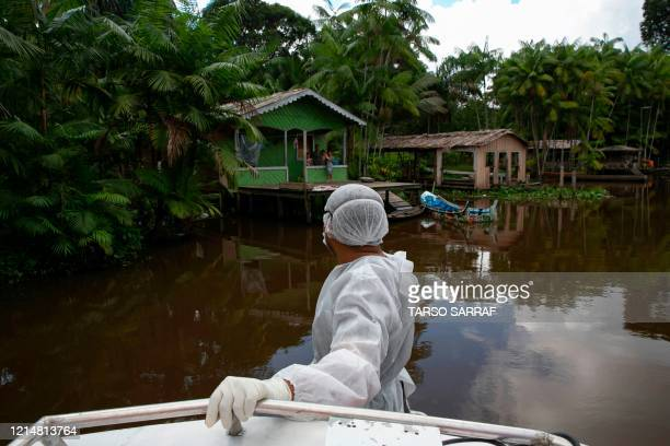 TOPSHOT Government health workers visit riverside communities of the municipality of Melgaco to test them for COVID19 coronavirus infections in the...