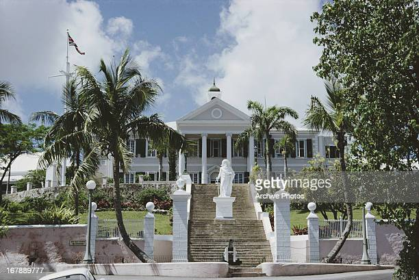 Government House in Nassau Bahamas circa 1968 It is the official residence of the Governor General of the Bahamas A statue of Christopher Columbus...