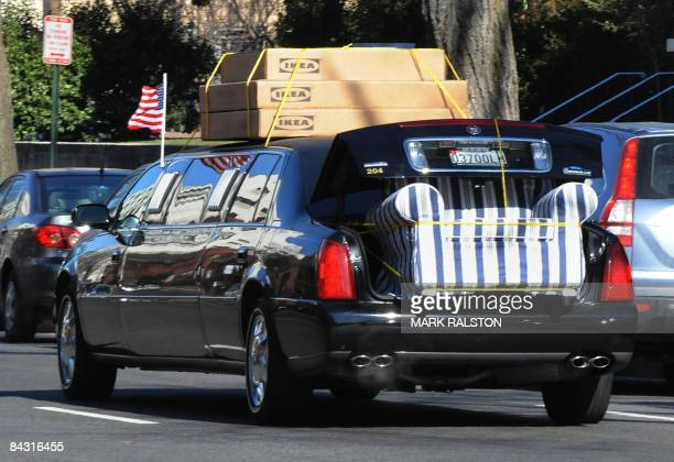 Government limousine drives past the US State Department building loaded with furniture from the Swedish furniture store IKEA in WashingtonDC on...