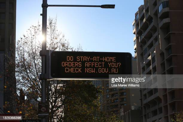 Government message is seen displayed on a digital sign on Oxford Street ahead of lockdown restrictions being imposed on June 25, 2021 in Sydney,...