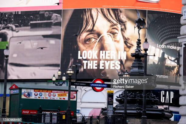 Government NHS advert displays the face of a Covid patient, urging Londoners to stay at home and not to take risks or bend the rules during the third...