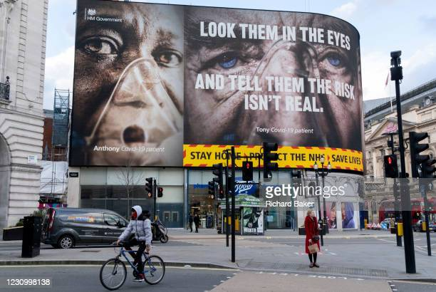 Government NHS advertisement displays the face of a Covid patient, urging Londoners to stay at home and not to take risks or bend the rules during...