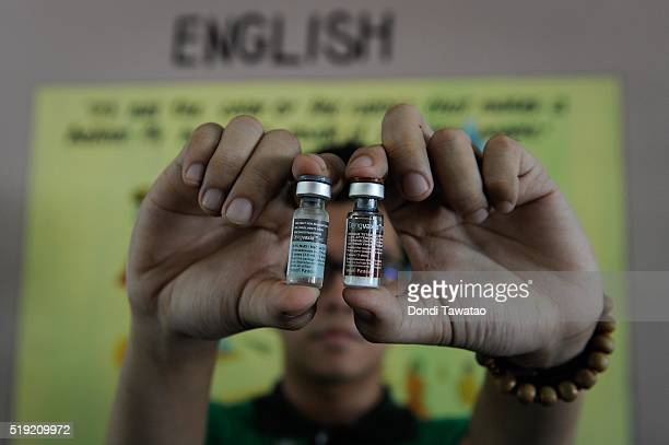 A government nurse holds up a vial of Dengvaxia the world's first licensed dengue vaccine on April 4 2016 in Manila Philippines The Philippines...