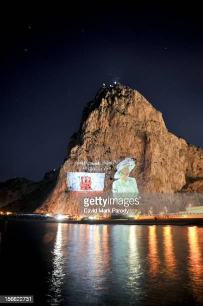Government of Gibraltar projects an image of Her Majesty Queen Elizabeth II and the Union Jack to commemorate the Diamond Jubilee of her reign.